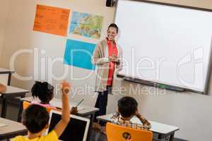 Teacher giving lesson to her students