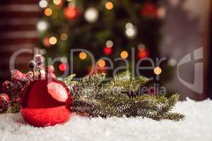 Composite image of Christmas bauble and holly