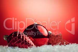 Composite image of Christmas bauble and pine cone