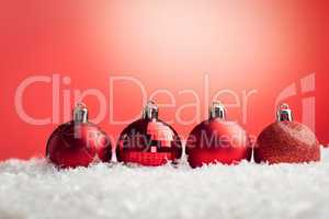 Composite image of Christmas baubles lined up
