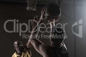 Portrait of men playing basket