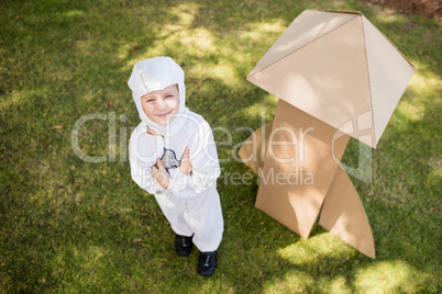 Above view of young boy pretending to be an astronaut