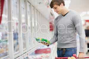 Profile view of man buying product
