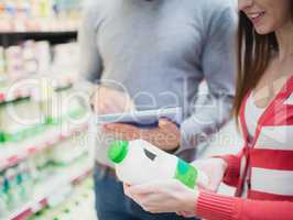 Close up view of couple doing grocery shopping together