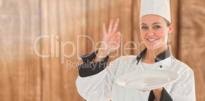 Composite image of portrait of a satisfying chef and holding an empty plate