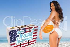 Composite image of travel insurance message on an american suitcase