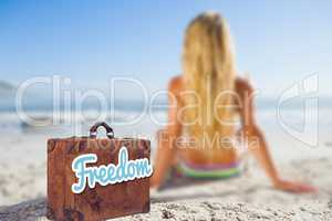 Composite image of old suitcase with the message freedom