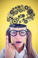 Composite image of female geeky hipster looking confused