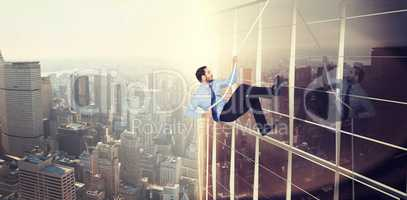 Composite image of businessman pulling a rope with effort
