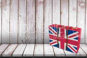 Composite image of great britain flag suitcase