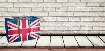 Composite image of great britain flag suitcase