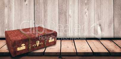 Composite image of wooden suitcase