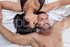 Woman kissing man in head and he pretty smiling