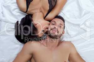 Top view of man smiling while hot woman kissed him