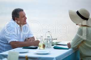 Middle-aged couple sitting waiting for a meal