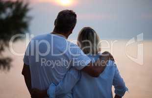 Romantic couple enjoying the sunset