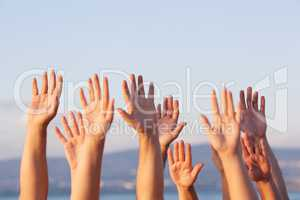 Unrecognizable people pulling hands in the air
