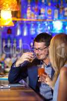Handsome man enjoying drinks with a woman