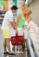 Family shopping together in a supermarket