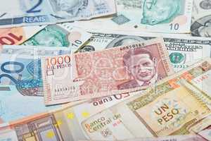 Background from paper money of the different countries. Colombian peso in the middle