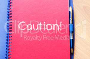 Caution write on notebook
