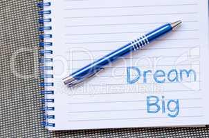 Dream big write on notebook