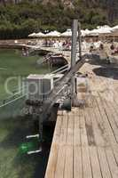 Disabled person pool lift meets installed by swimming lake to lower people into water photo