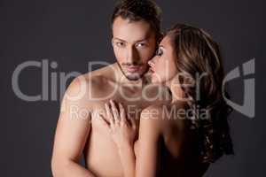 Nude. Image of beautiful young lovers hugging