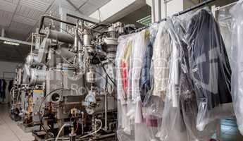 Image of modern equipment and clothing on hangers