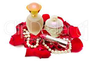 Perfume and pearl necklace in rose petals