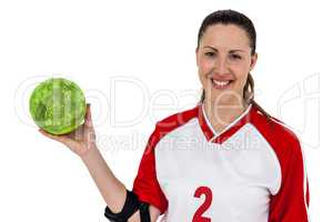 Sportswoman posing with ball