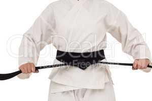 Fighter tightening karate belt