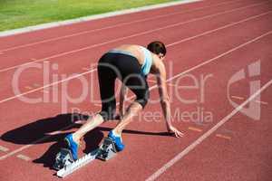 Female athlete ready to run