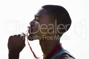 Athlete kissing his gold medal