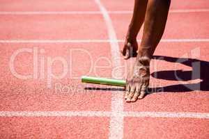 Hands of athlete holding baton