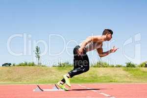 Athlete running on the running track