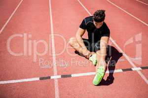 Athlete warming up on the running track