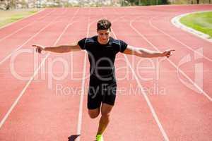 Athlete running on running track