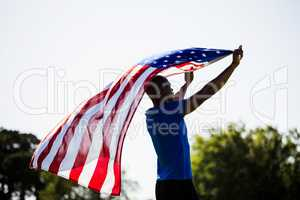 Athlete holding an american flag