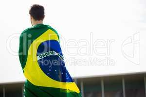 Athlete with brazilian flag wrapped around his body