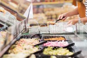 Woman choosing prepared meal