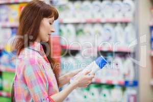 Profile view of woman choosing detergent