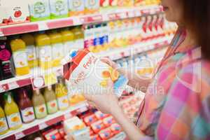 Close up view of woman buying fruits juice