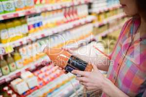 Close up view of woman choosing a bottle of fruits juice
