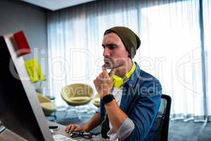 Concentrated hipster man working with audio headset