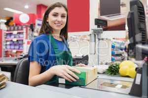 Portrait of woman cashier smiling