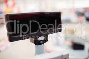 Focus on foreground of the cash register screen