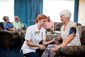 Nurse taking care of pensioner