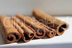cinnamon sticks lie close together, daylight