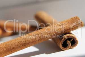cinnamon sticks lie one to another, daylight